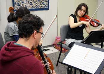 UI violinist, cellist, and clarinet player rehearse.