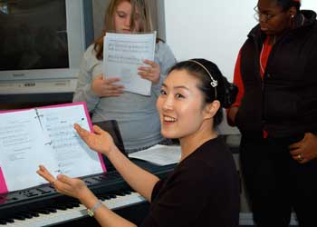 music education students singing and at a piano