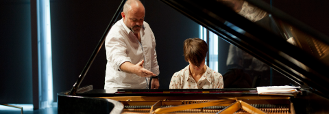 Piano Professor Alan Huckleberry teaching a student.