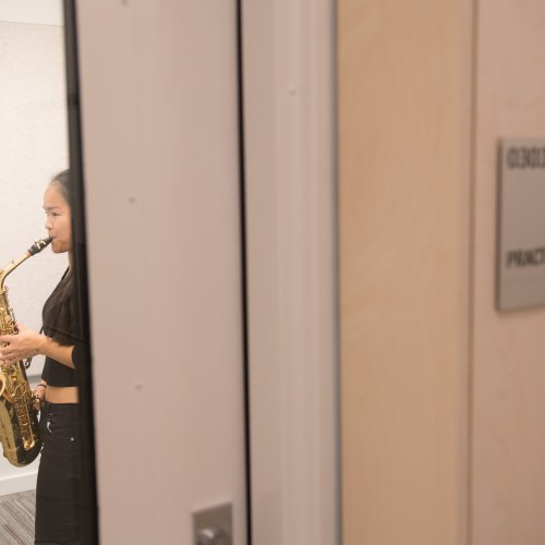 saxophonist in a practice room