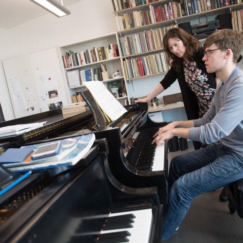 piano professor and student in a lesson