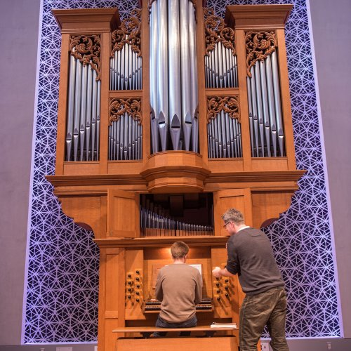 organ professor teaches a lesson in the organ hall