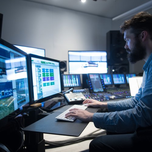 a recording engineer at work in the recording studio