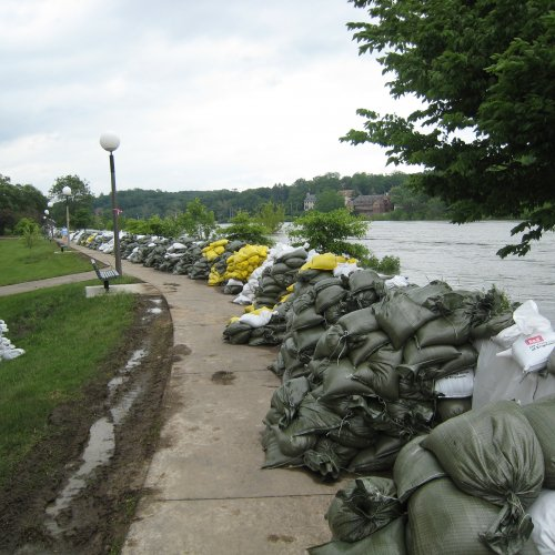 Thousands of sandbags line the Iowa River in an attempt to keep flood water at bay.