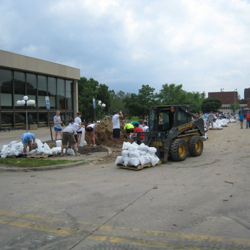 Volunteers from throughout the community helped load and move sandbags to protect UI buildings.