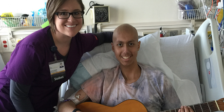 Emily Guthe with a patient in the hospital