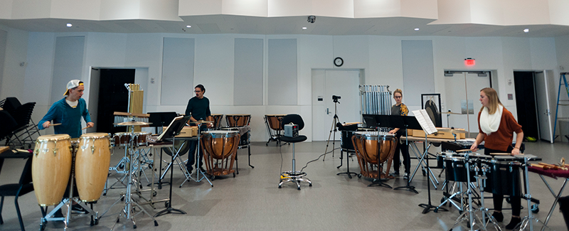 a percussion ensemble rehearses