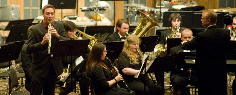 Photo of Oboe Professor Andy Parker performing with the UI Symphony Band.
