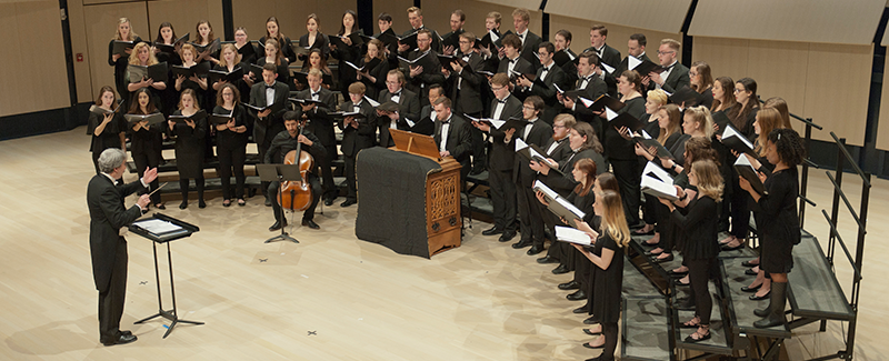 A choral ensemble performs in the concert hall.