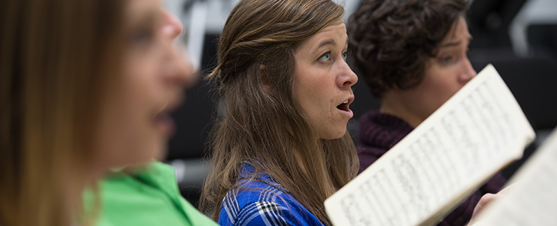 female singer in a choir rehearsal
