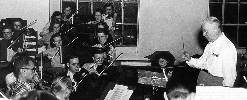 P.G. Clapp conducts the orchestra
