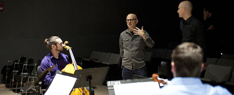 Alumnus composer David Lang speaks to a string quartet during a rehearsal
