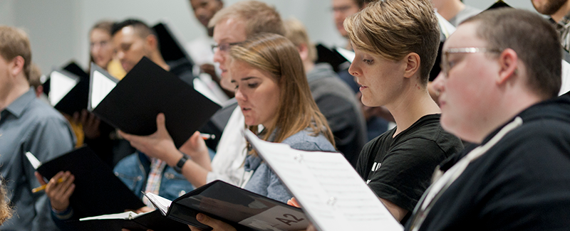 Choral musicians in rehearsal.
