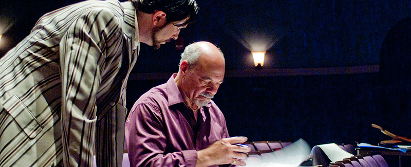 Professor William Jones reviews a score with an opera cast member.