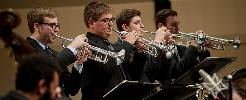 Johnson County Landmark trumpet section on stage in concert hall