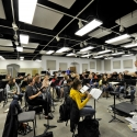 Mark Heidel conducts a rehearsal of the symphony band in the Band Room of Music West Interim Building.