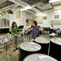 Percussion Professor Dan Moore works with a student in the percussion room of Music West Interim Building.