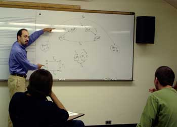 Theory Professor Robert Cook teaches a class.