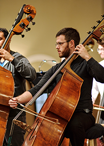 double bass section in rehearsal
